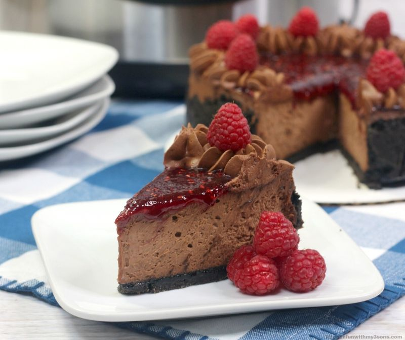 Copycat Chocolate Raspberry Cheesecake on a white plate
