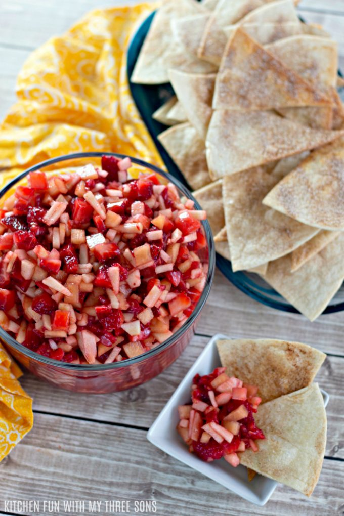 Fruit Salsa with Cinnamon Tortilla Chips on a wood table with a yellow napkin