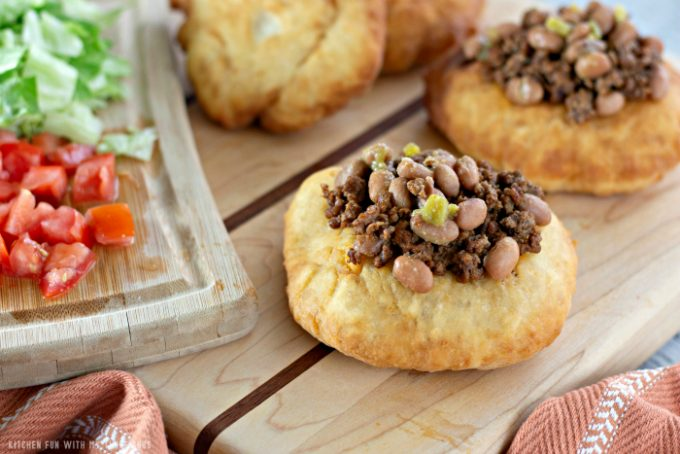 topping Soft and Fluffy Fry Bread Tacos with beef and beans