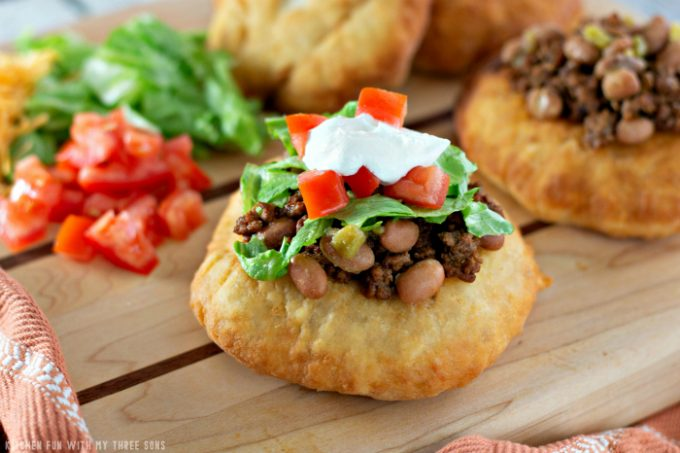 Soft and Fluffy Fry Bread Tacos on a wood cutting board