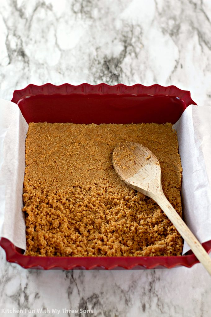 graham cracker crust in a square baking dish