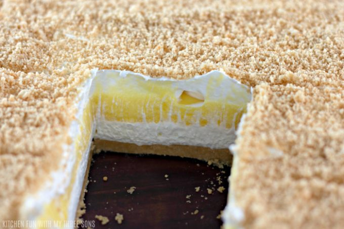 slicing the lemon lasagna to reveal the creamy layers