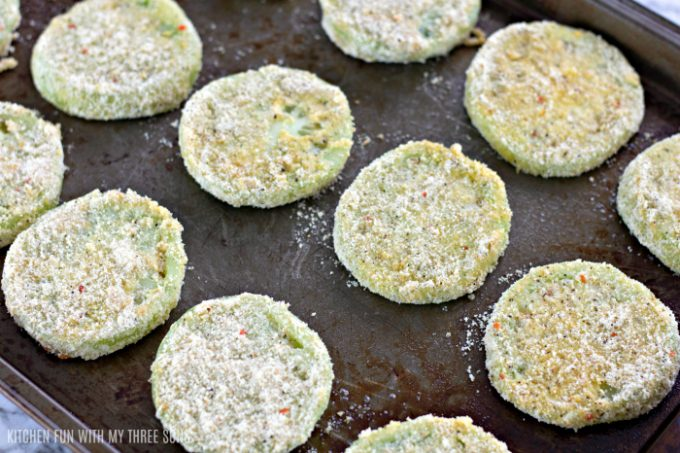 breaded green tomatoes on a baking sheet