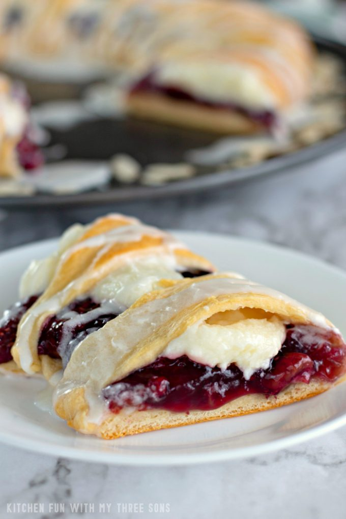 Slice of Raspberry Cheese Danish Ring on a white plate