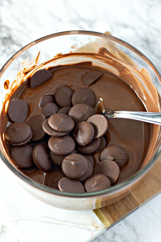 melting dark chocolate in a clear bowl