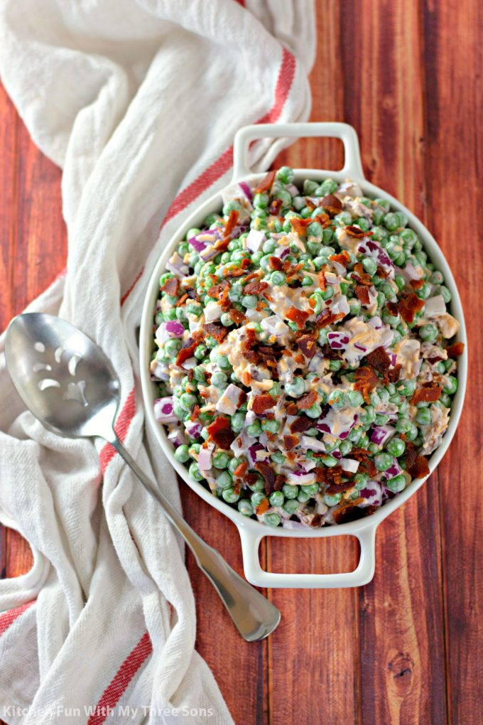 Bacon Pea Salad Recipe in a white bowl on a wood table