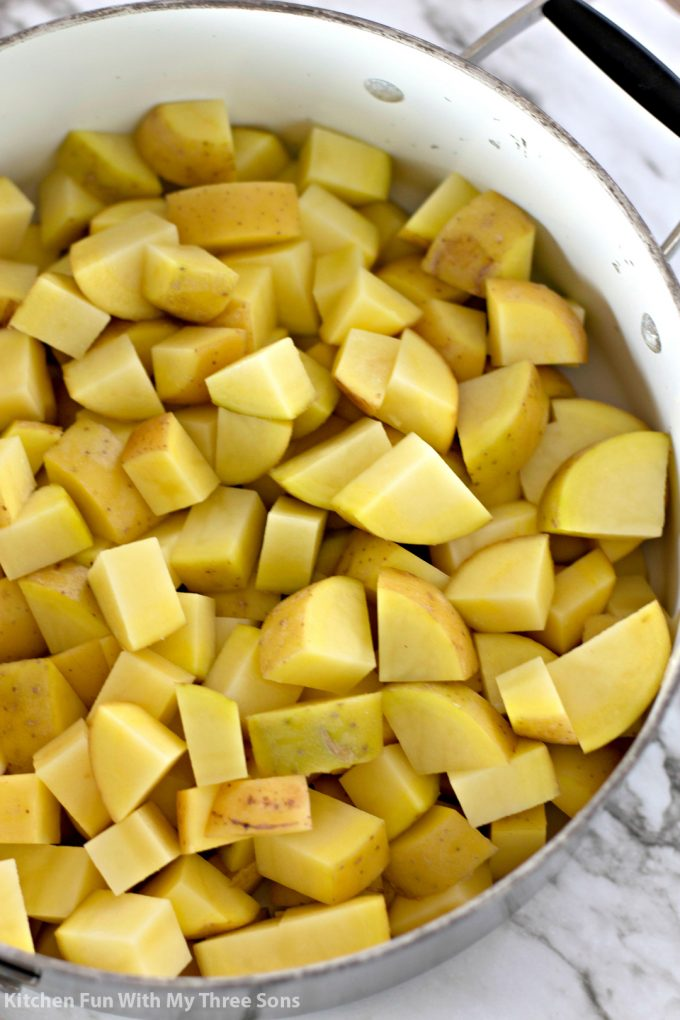 cubed yukon gold potatoes in a white pot