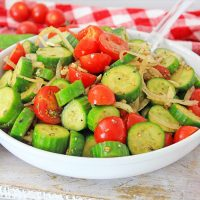 Cucumber Tomato Salad is a simple summer side dish loaded with flavor and healthy veggies. It's topped with an easy homemade Italian dressing.