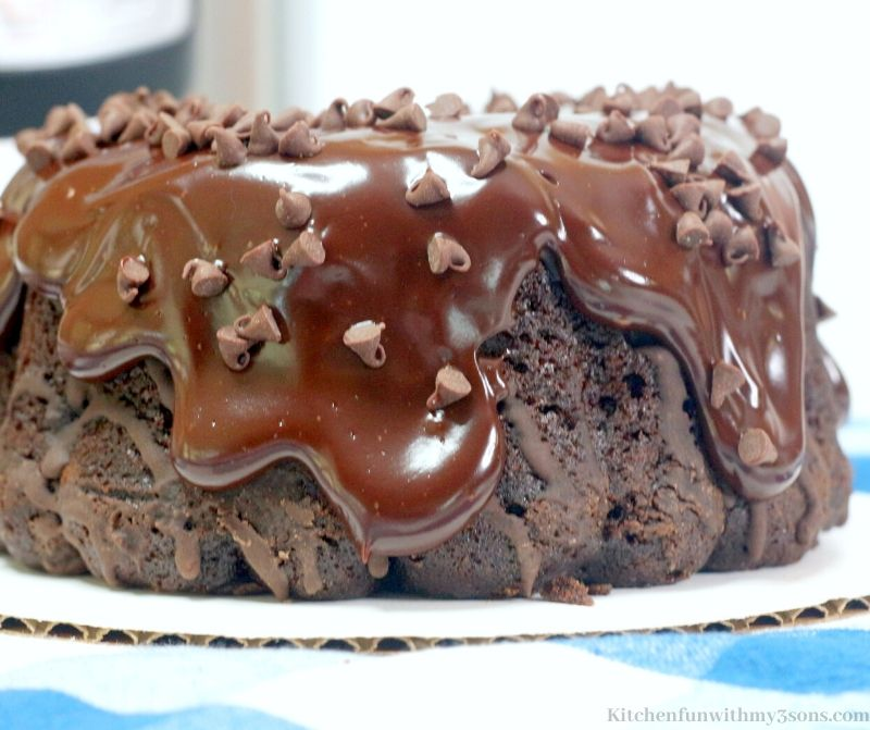 whole chocolate cake with ganache and chocolate chips