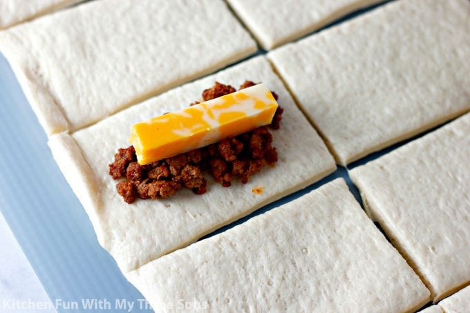 rectangles of pizza dough topped with taco meat and cheese