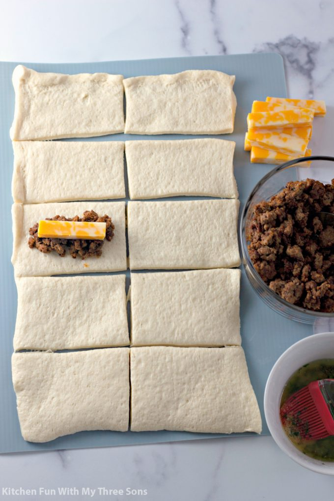 stuffing pizza dough with taco meat and cheese