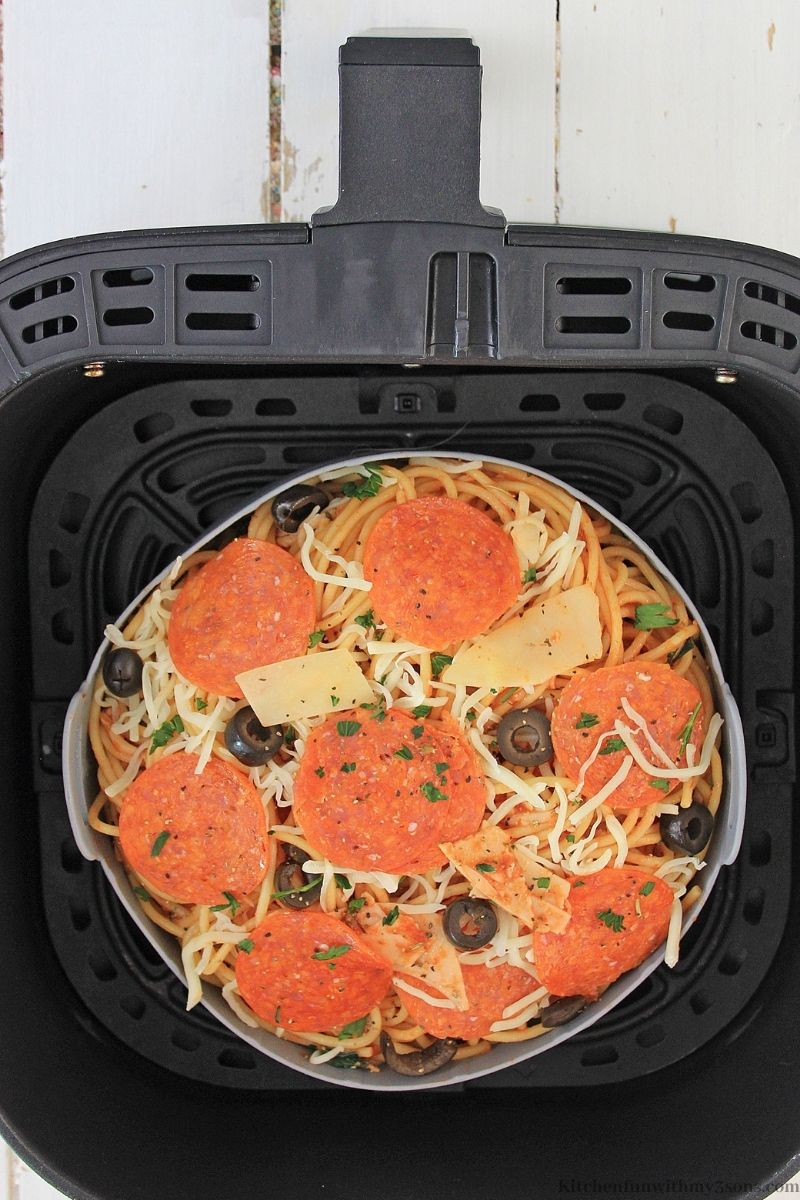 Placing your now prepared Pizza Pasta for cooking in the Air Fryer.