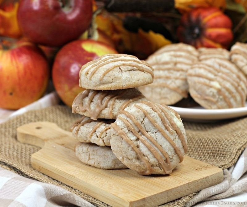 Apple Pie Cookies with Spiced Glaze with apples in the background