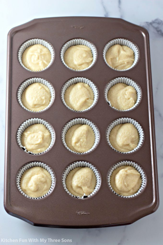 cake batter in a muffin pan ready to be baked