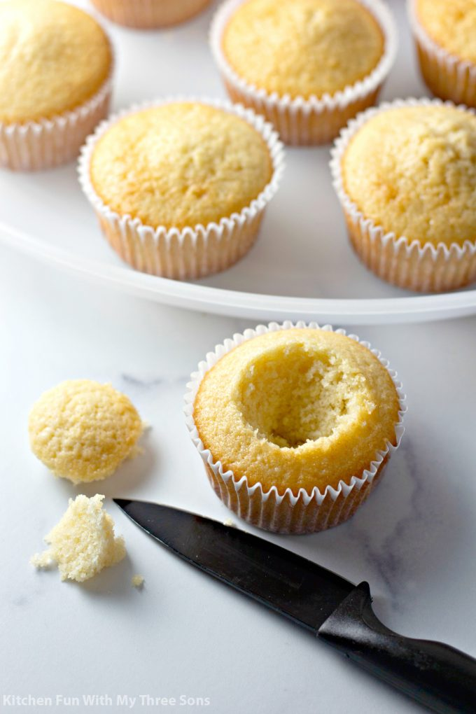 cutting out the center of the cupcakes