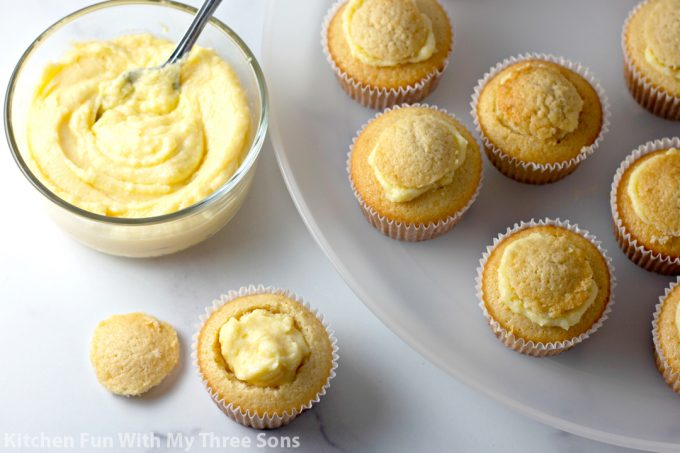 filling the cupcakes with pastry cream