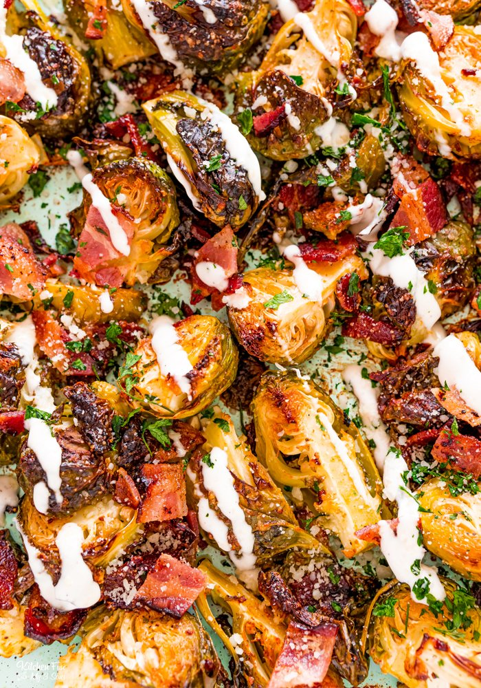 Brussel Sprouts with bacon and ranch all roasted and covered in parmesan cheese is the side dish you'll want to make for every dinner. Even picky eaters like this recipe!