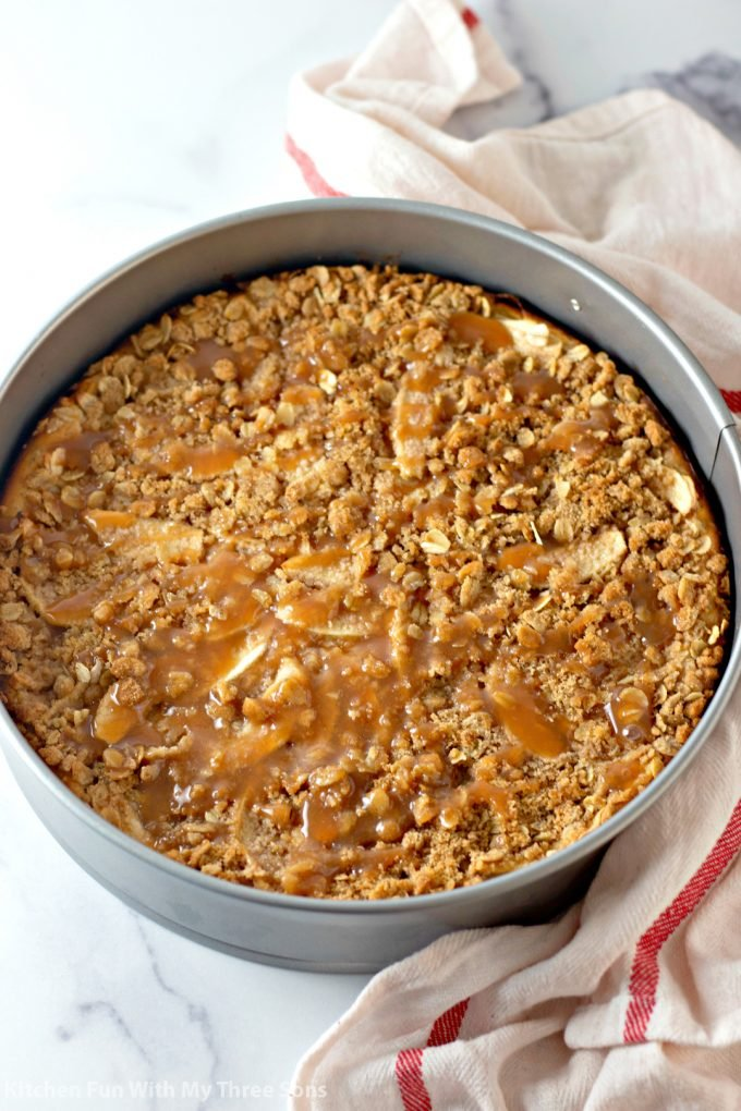 finished Caramel Apple Crisp Cheesecake in the pan