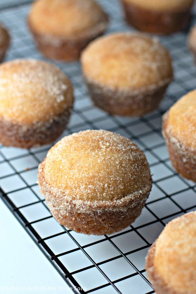 Cinnamon Sugar Donut Muffins on a wire cooling rack