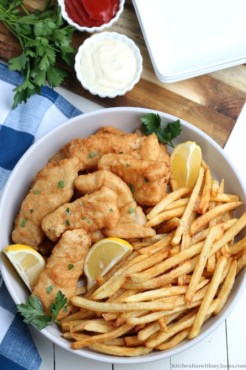 Classic Fish and Chips Recipe with a sides of dipping sauces.