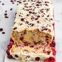Cranberry Pound Cake is a delicious vanilla pound cake recipe full of fresh cranberries and topped with a creamy homemade icing.