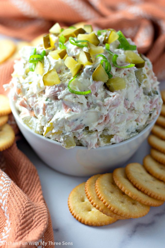 Dill Pickle Dip in a white bowl with crackers