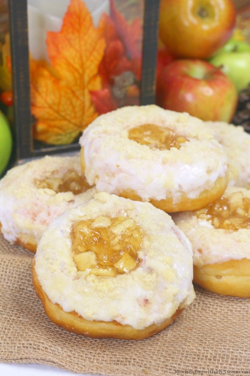 Easy Apple Donuts Recipe on a cutting board.