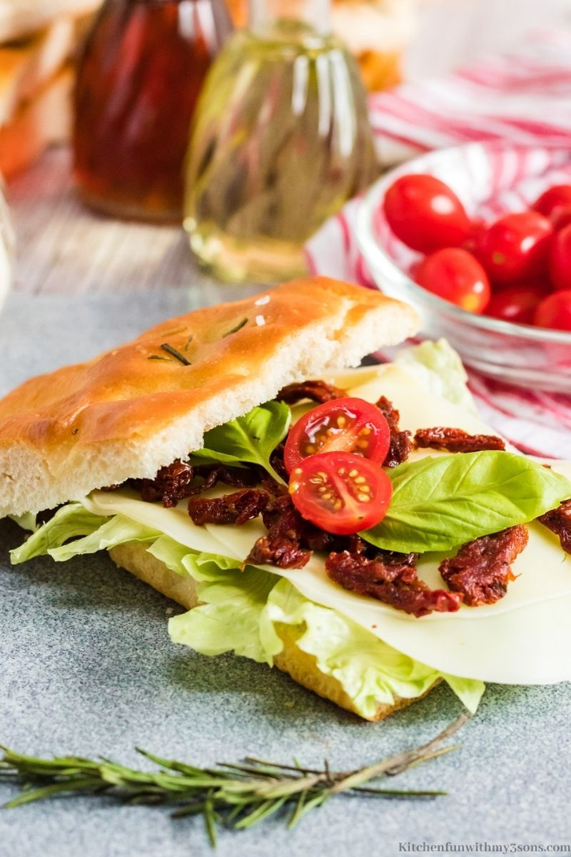 Focaccia in the form of a sandwich with a side of cherry tomatoes