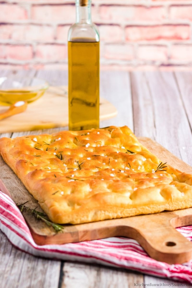 Baked Focaccia on a cutting board.