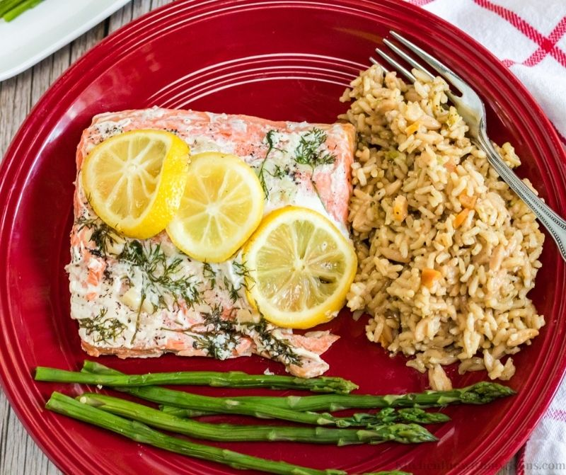 Instant Pot Salmon and Rice on a plate with aspargus.