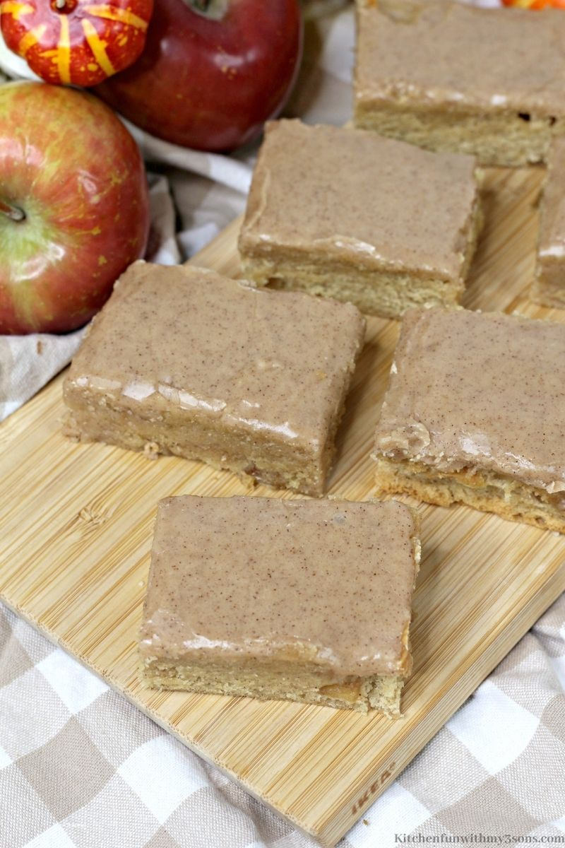 The Pumpkin Apple Blondies with Maple Glaze bars arranged on a cutting board.