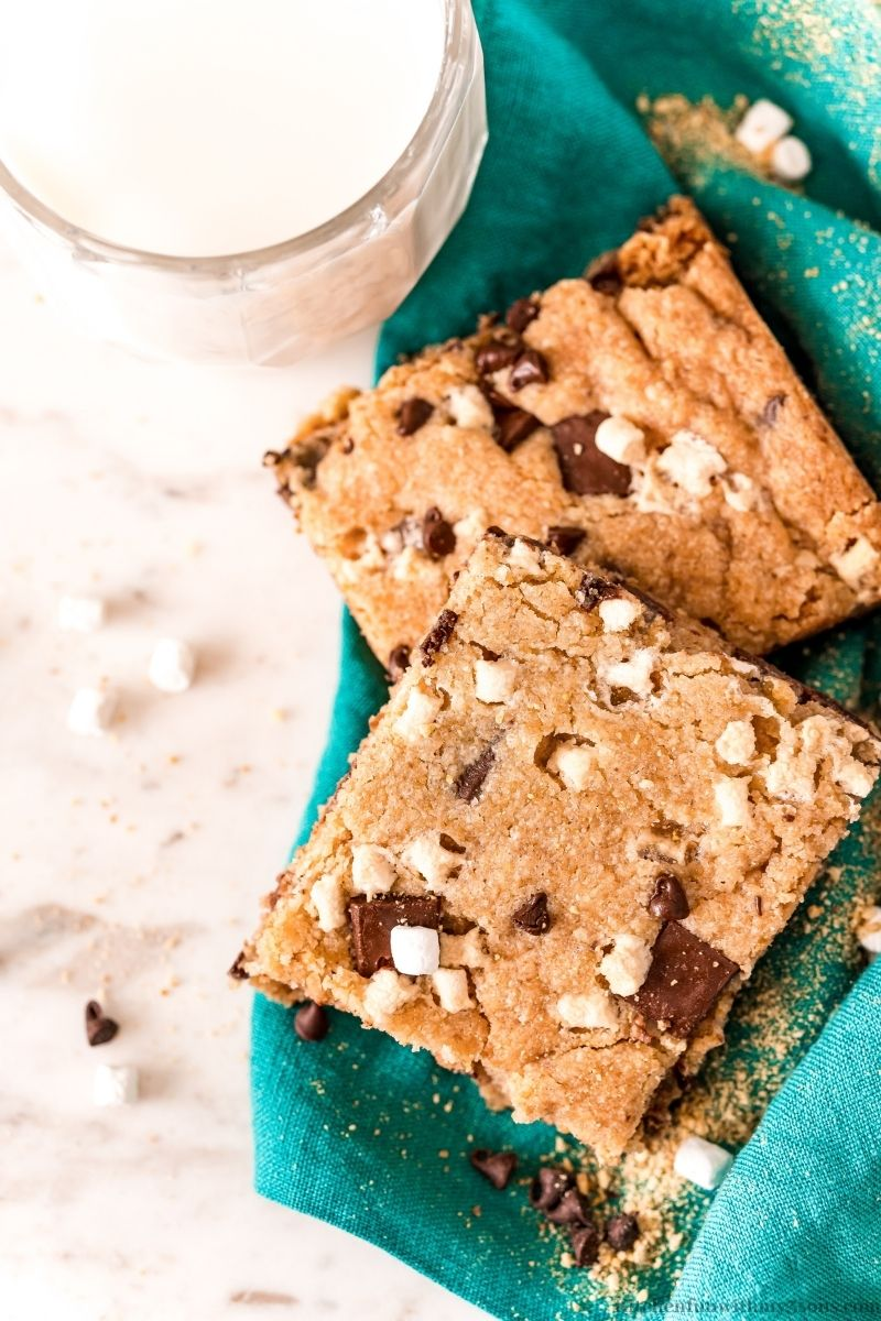 S'Mores Cookies Bars Recipe with a glass of milk on the side.