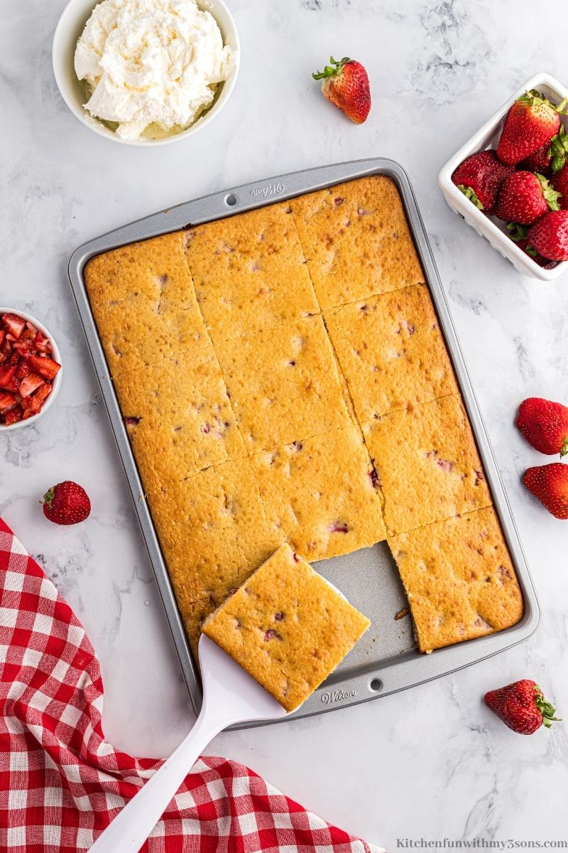 The pancakes in the sheet pan cut into squares.