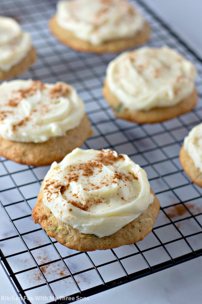 Zucchini Cookies with Cream Cheese Frosting on a wire cooling rack