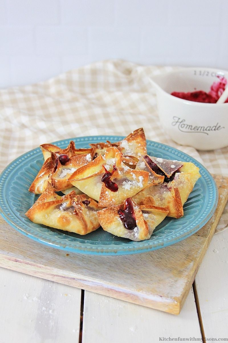Air Fryer Blueberry Cheesecake Wontons on a serving plate.
