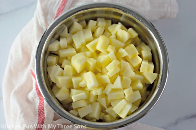 chopped apples in a metal bowl