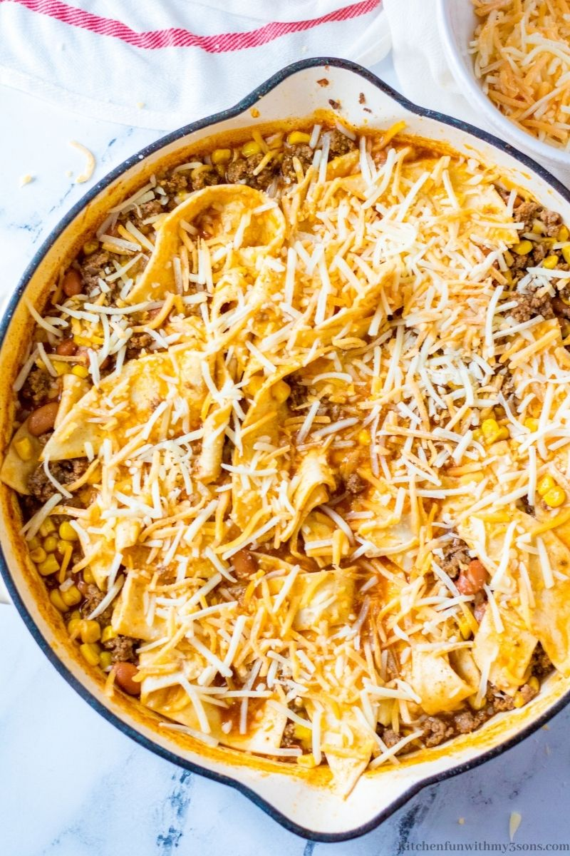 Beef Burrito Skillet One Pot Meal topped with sprinkle cheese.