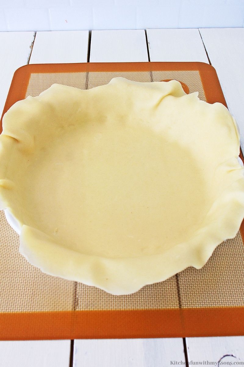 Placing the dough in your prepared pie pan.