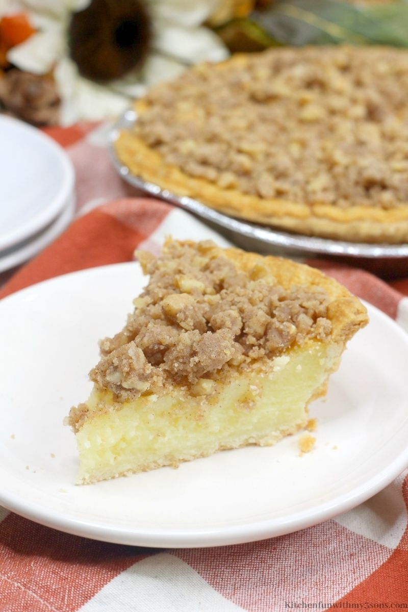 Buttermilk Pie with Walnut Streusel on a red and white patterned cloth.