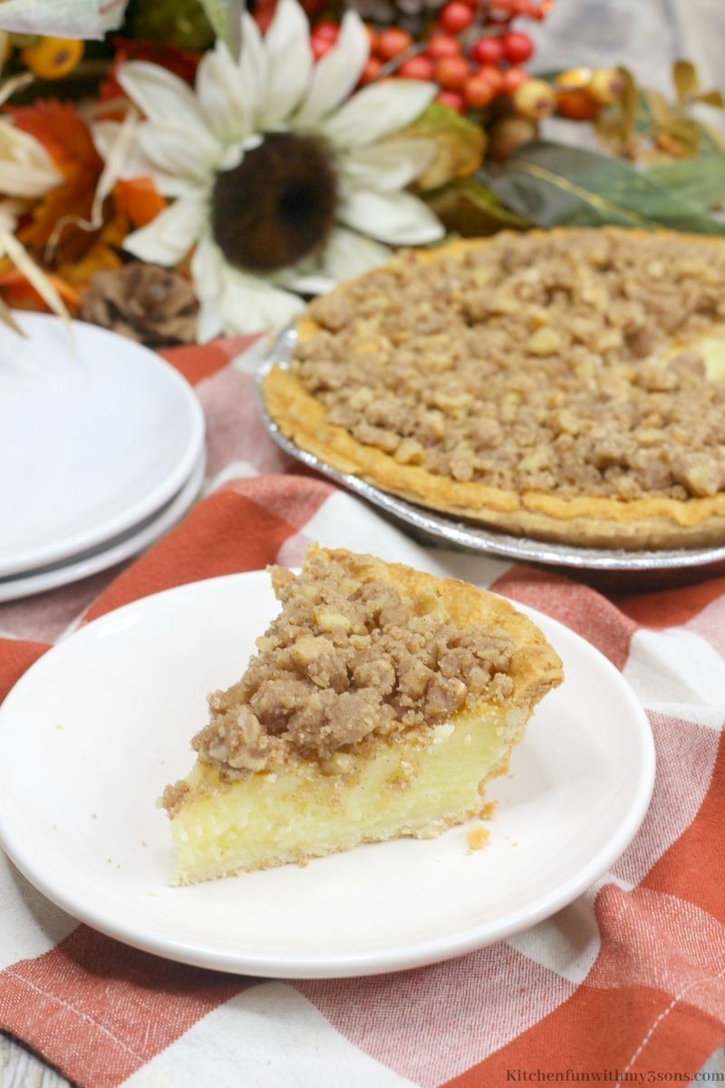 Buttermilk Pie with Walnut Streusel on a serving plate.