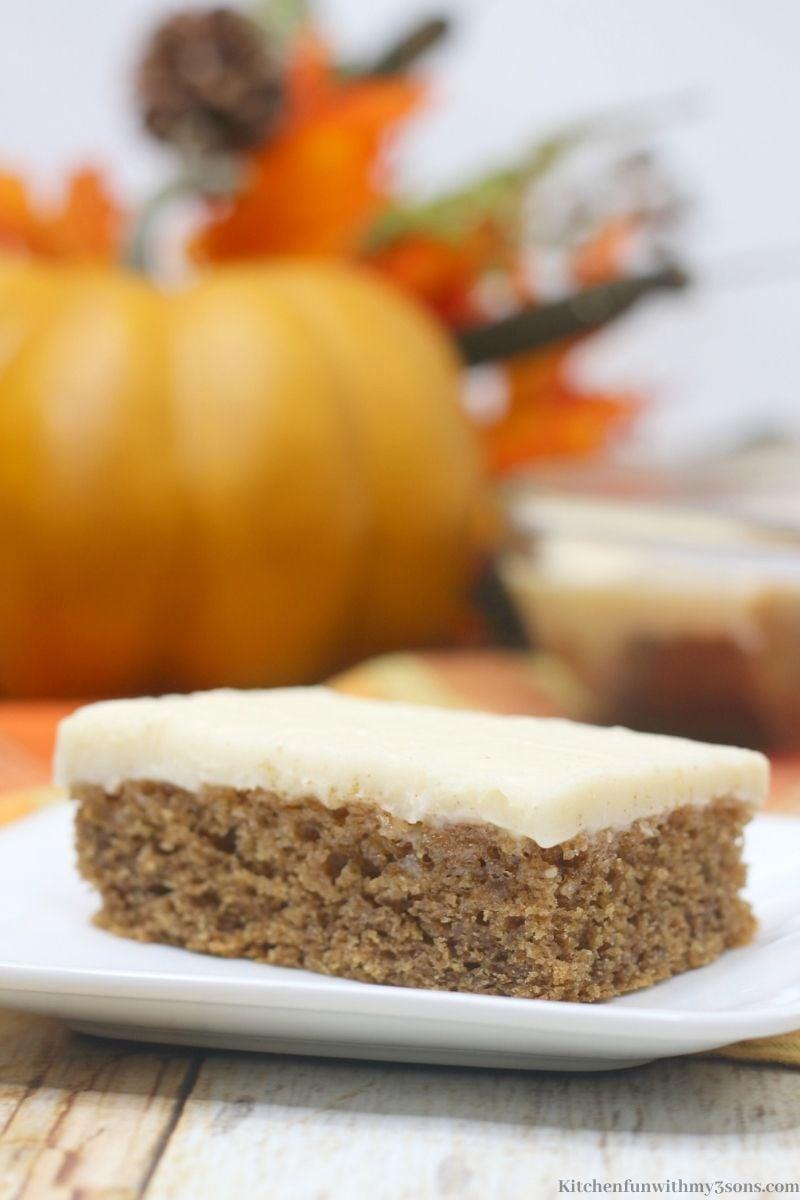 Caramel Apple Texas Sheet Cake with a pumpkin behind it.