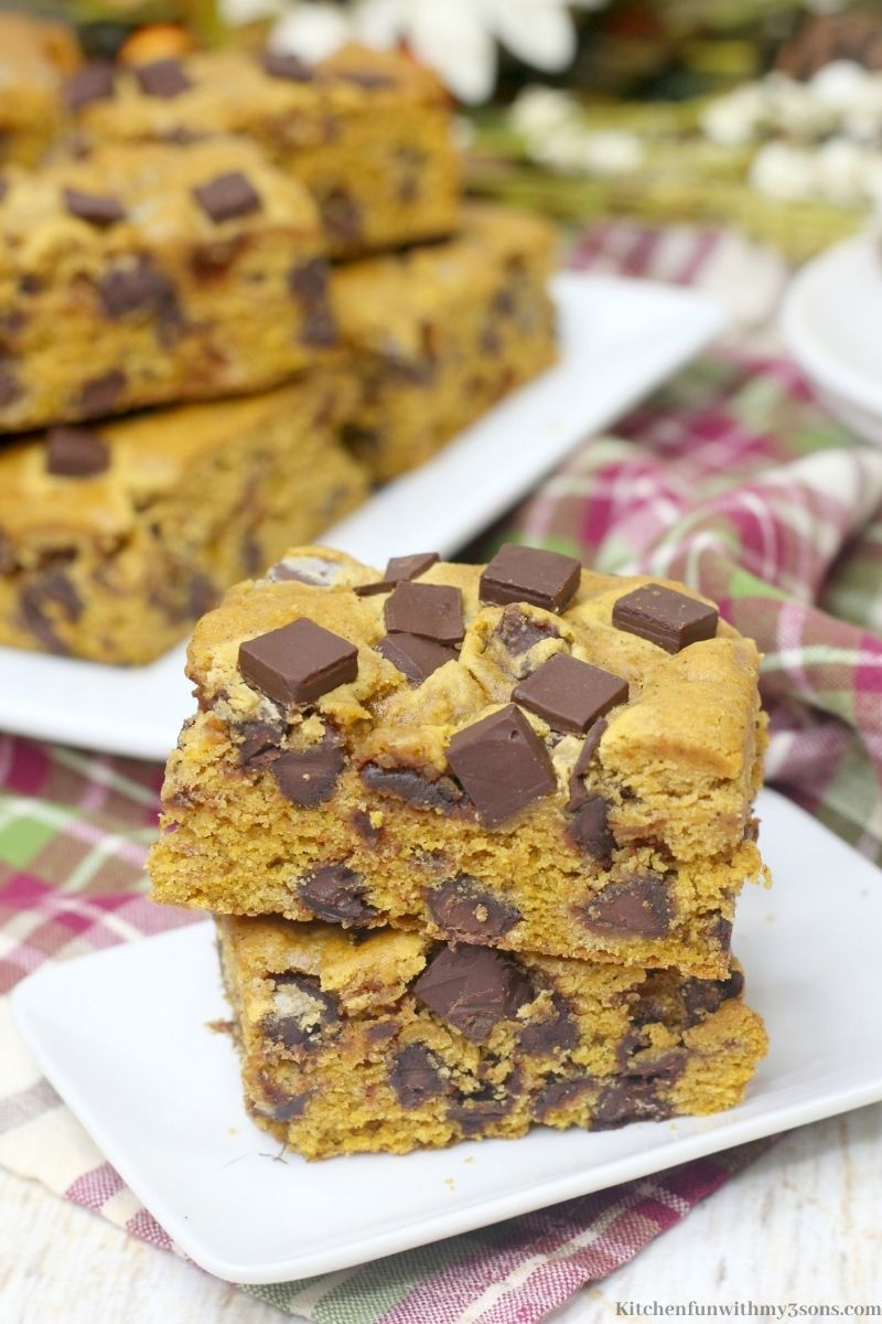 Chocolate Chunk Pumpkin Bars stacked on top of each other on a serving dish.