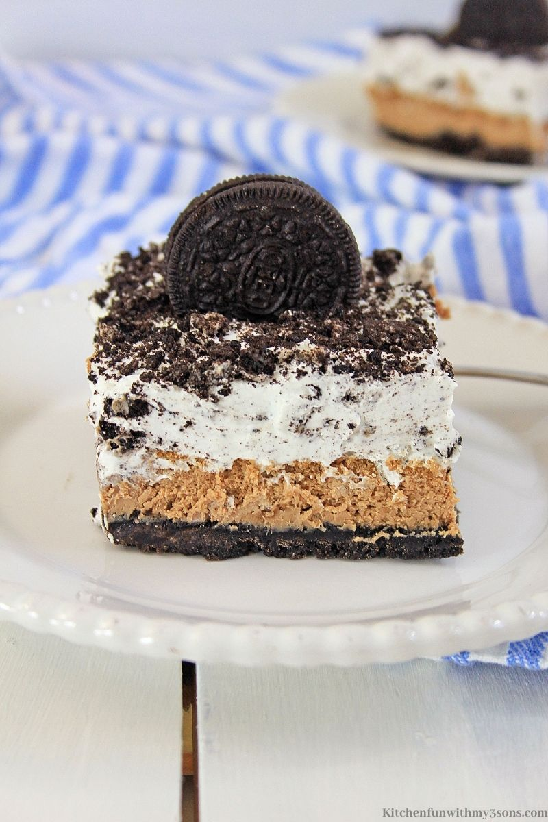 Chocolate Oreo Cheesecake Bars Recipe on a blue and white patterned cloth.