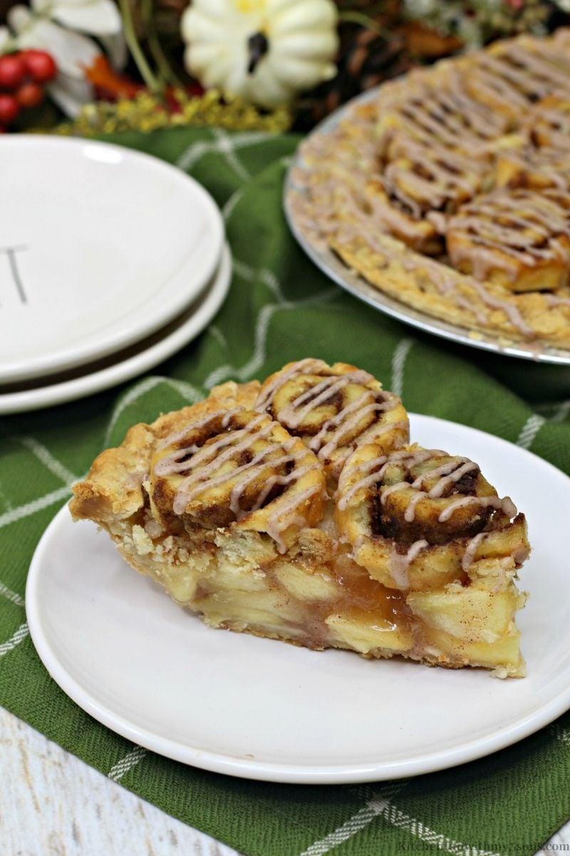 Cinnamon Roll Apple Pie Recipe on a serving plate.