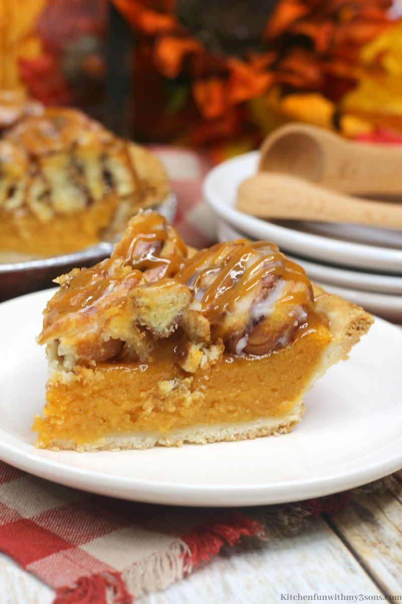 Cinnamon Roll Sweet Potato Pie Recipe with Fall decorations behind it.