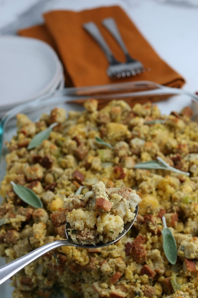 The Cornbread Dressing Recipe being scooped up with a spoon.