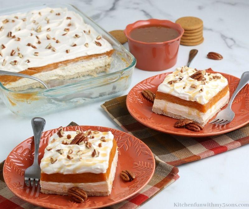 Easy Pumpkin Dessert Lasagna Recipe on serving plates with pecans.