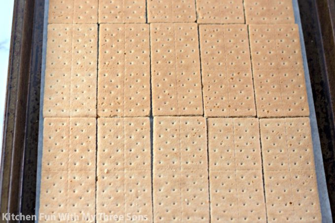 graham crackers layered on a cookie sheet