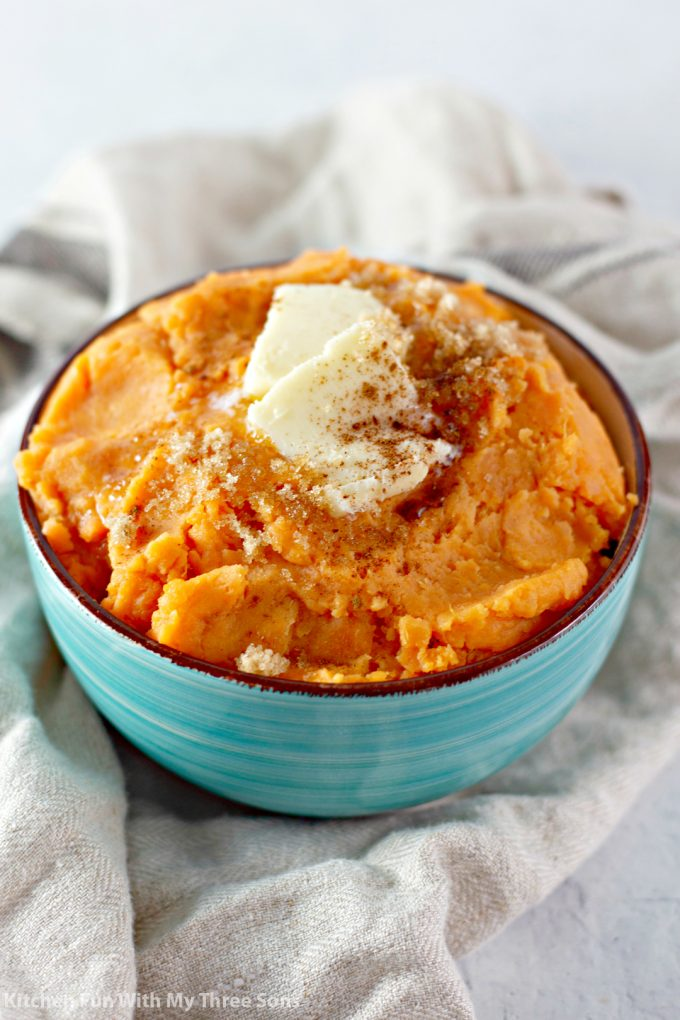 Mashed Sweet Potatoes with butter, brown sugar, and cinnamon on top