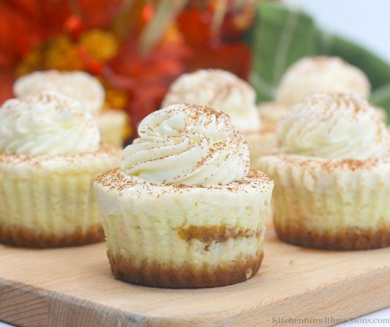 Mini Pumpkin Swirl Cheesecake with Fall decorations behind it.